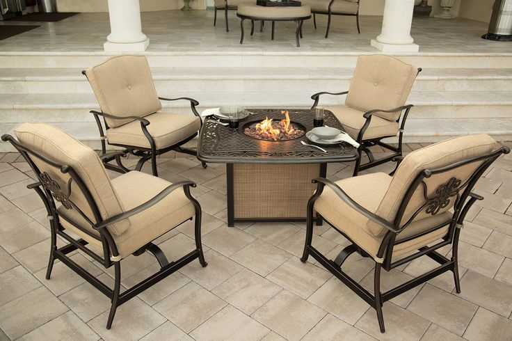 Hanover 5-Piece Traditions Outdoor Cast Tabletop Fire Pit Lounge Set, Natural Oat/Antique Bronze. Includes 4 deep-seating rocker chairs and 1 square LP gas fire pit with cast tabletop. 30,000 BTU LP gas fire pit holds 20 lb. tank in concealed chamber (gas tank not included). Rust-resistant, all-weather cast aluminum frames. Plush, foam cushions wrapped with treated olefin fabric to resist moisture, stains and UV harm. Some assembly required-hardware provided.