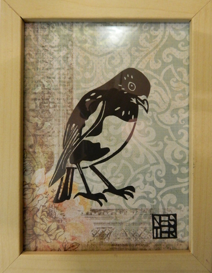 Lino Cut print of a Robin, printed onto patterned paper in a wooden frame behind glass. 230mm x 175mm  $60 NZD  made in New Zealand By Esther Remnant  see more of her work here  http://coolstoregallery.co.nz/EstherRemnant.htm