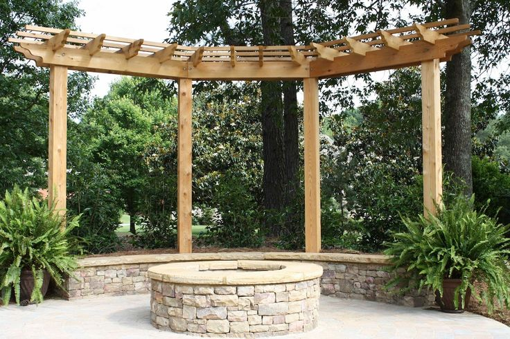 Stacked Stone Firepit With Seating Wall And Pergola