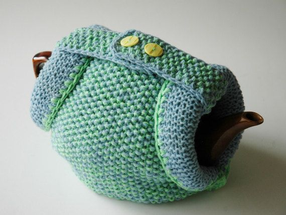 Knitted tea cosy in blue and green wool by KororaCrafters