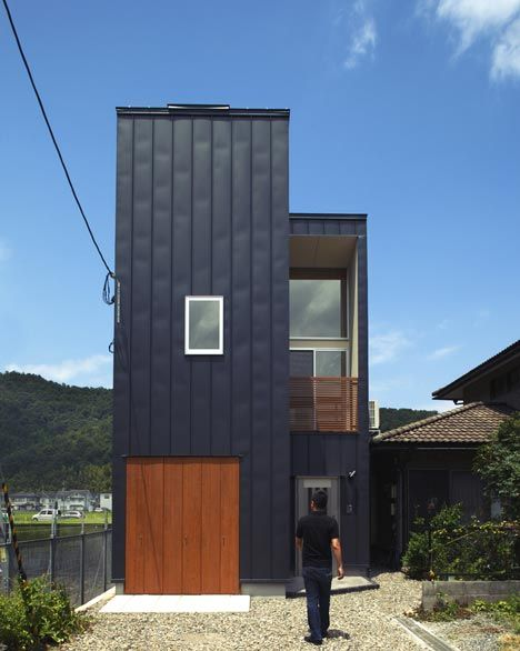 This house is completely wrapped in a material normally used for roofing.