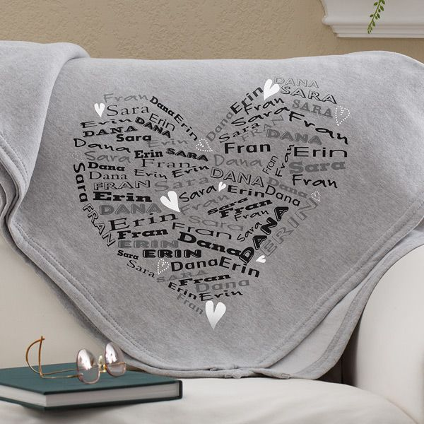 Super soft sweatshirt blanket is personalized with up to 8 loved one's names printed in a repeating fashion in a cute heart shape.