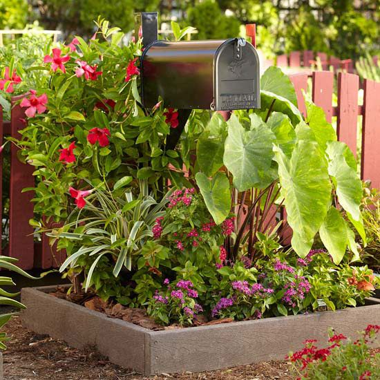 """To Boost Your Home's Curb Appeal In a Day Do a mailbox makeover """"Mailboxes should complement the home and express the homeowner's personality. When choosing a hanging drop box, pick a box that mirrors your home's trimmings. Dress up mail boxes by painting the wooden post to match the house's exterior color, or by surrounding it by a beautiful flowering garden."""""""