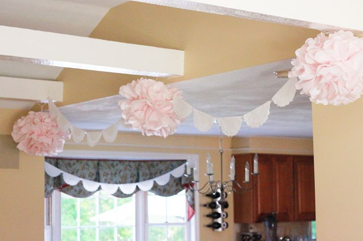 Leah's baptism decor-Tissue poms and doily banner