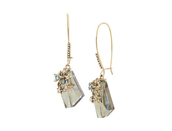 "A large opaque stone dangles from a crystal accented shepherd hook earring, while tiny crystal accented star charms add a pop of shine.  Gold tone drop earrings featuring a large blue iridescent drop stone with tiny hearts with clear and blue tonal stones     Shepherds Hook         Antique gold tone hardware Metal/glass/CZ     Length: 2.7""     Width: 0.6""     Drop: 1.2"""