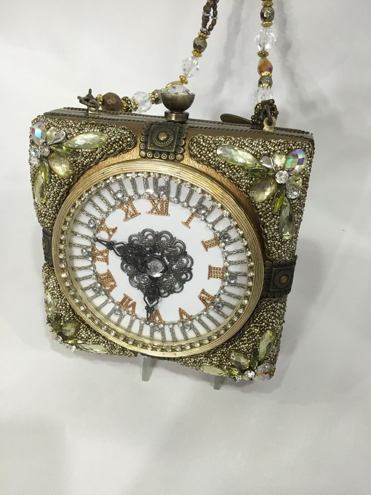 Time will stand still in the beautiful fashion art bag from Mary Frances. Small beaded evening bag with beaded strap.