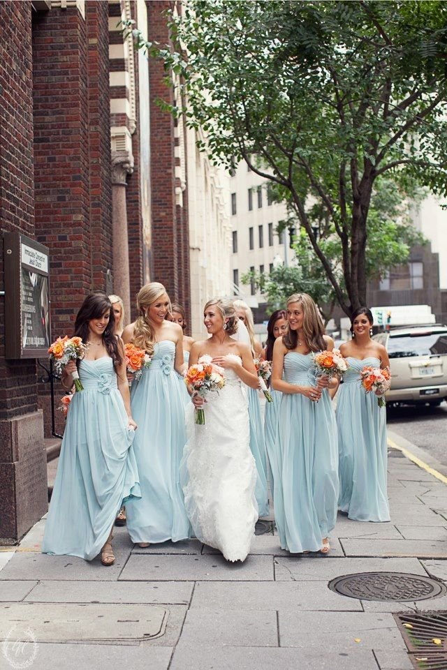 Wedding from this past summer. We thought the coral was a very striking combination with their tiffany blue dresses