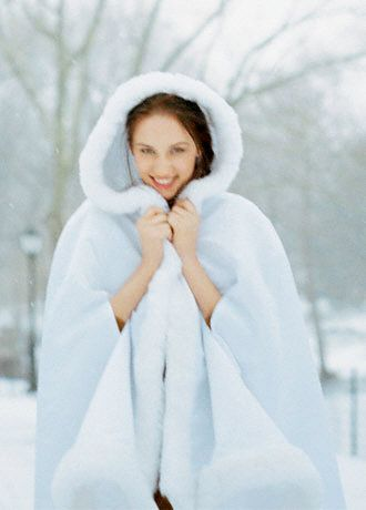 Faux fur bridal cape. This is from David's Bridal and is only $125.