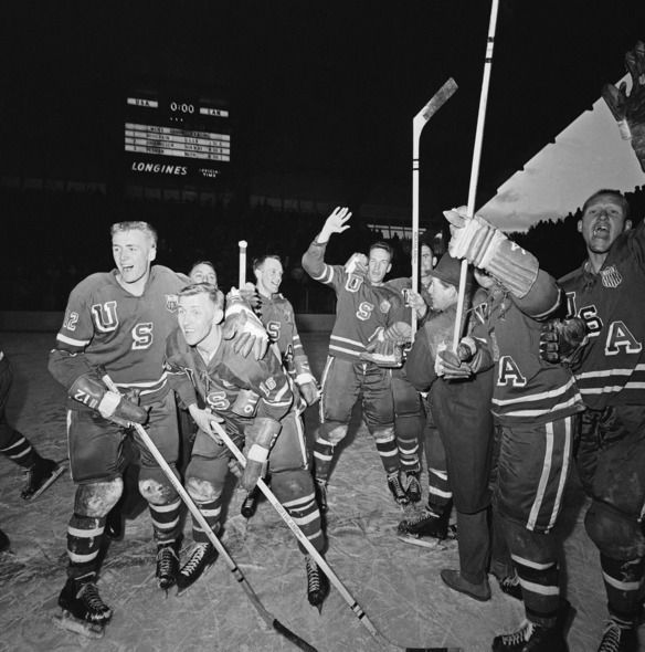 "American hockey players cheer their upset victory over Canada in the Winter Olympics a few minutes after the game ended on Feb. 25, 1960, in Squaw Valley, California. Often called ""the forgotten miracle,"" the U.S. upset vastly superior Canadian and Soviet teams with Cold War tensions creeping in. 