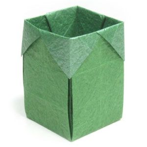 "Photo diagrams for an origami open box.  Easy.  6.5"" paper makes a 1.5"" wide  by 2.5"" tall box."
