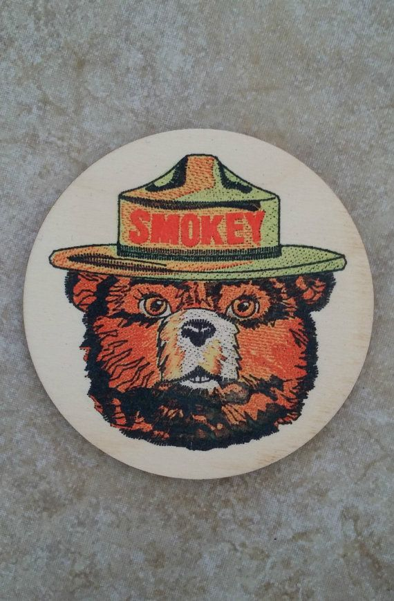 Set of 4!!! Dont miss these real wood coasters! They feature the iconic Smokey Bear image. A portion of each sale goes towards promoting Smokeys message of fire safety and prevention! We use a specialized technique to transfer the image onto the wood. The image will have a vintage, slightly muted aged look to give it that Old World appearance. Image will not smear or run even if submerged in water! All of our items are proudly crafted in the USA right here on the Big Island of Hawaii.......