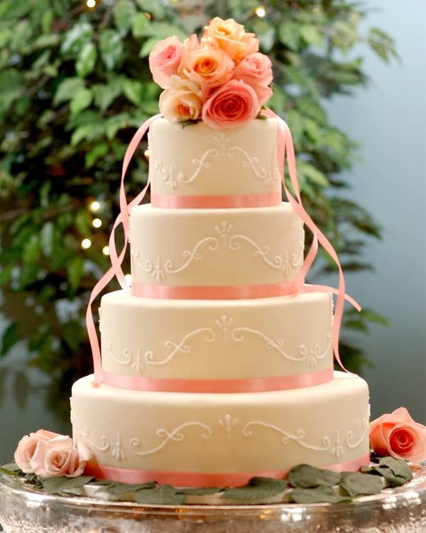 love the flowers and ribbons on each tier