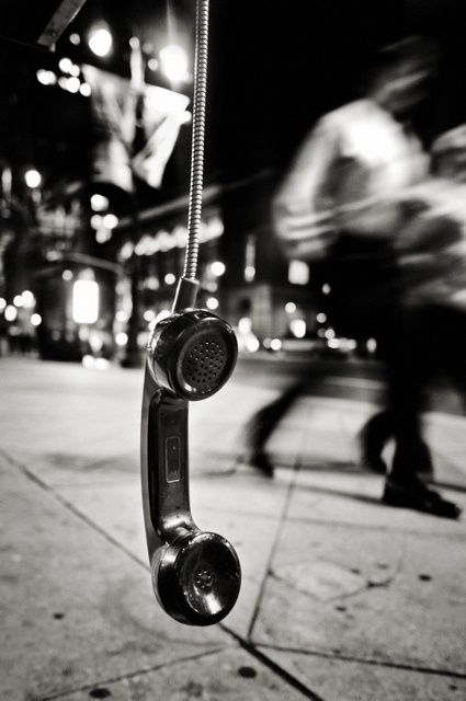 Philadelphia 471 by Michael Penn Street   Photography - This is a great image because of the contrast between the dangling   phone and the blurred people in the background. It seems ironic that the phone   is still and not swinging while the rest of the image is in   motion.