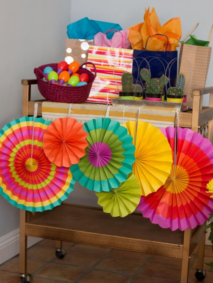 DIYNetwork.com shows you how to throw a Mexican-style gender reveal party use a big pinata to let everyone know if it's a boy or girl.