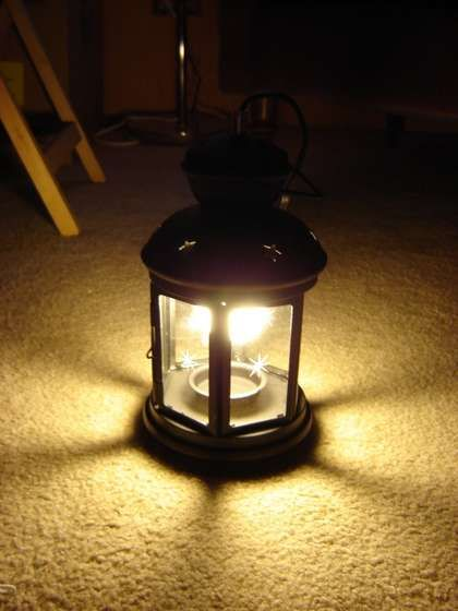 Covert a tea light lantern to an electric light...maybe for pendants in kitchen using lanterns from my wedding...