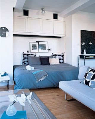 """Small Studio Apartment Big Ideas"""" Use drapes to separate bed from rest of apartment. If I ever have that type of place! Love the art right by the bed."""