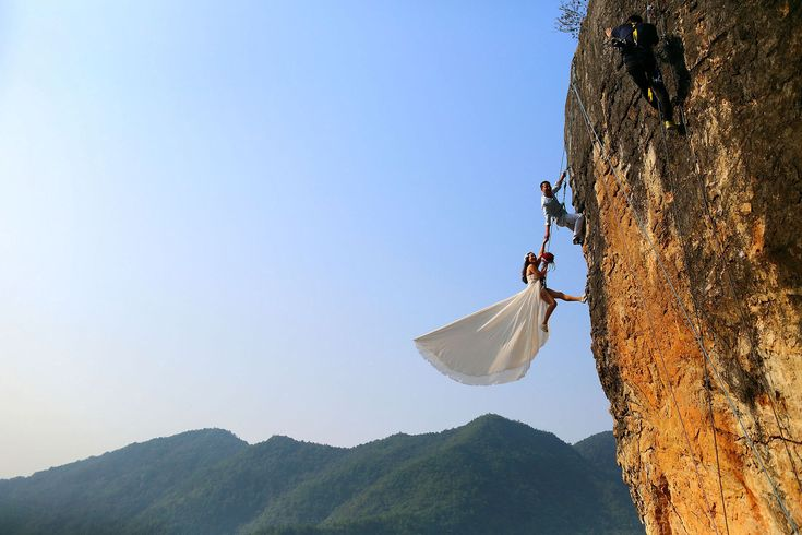 74 Of The Most Amazing News Photos Of 2014 - BuzzFeed News. Zheng Feng, an amateur climber, takes wedding pictures with his bride on a cliff in Jinhua, Zhejiang, province, China, on Oct. 26. China Daily