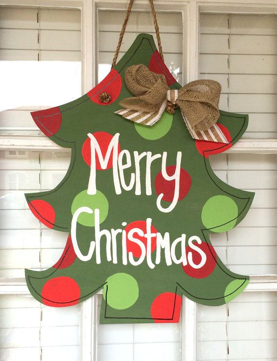 Adorable Merry Christmas green Christmas tree. Red and green ornaments. Can customize to your specifications. Each door hanger is made of plywood and