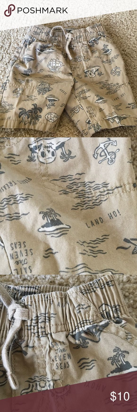 """JUMPING BEAN 💯% Cotton KHAKI Shorts SEA LIFE 2T Sweet KHaki shorts w/ drawstring waist that is also elasticized. 2 slash side Pockets, fake fly front. AHOY! LAND HO! PIRATE TREASURES ! Palm trees, islands anchors. 2T...18"""" fully around unstretched  can stretch more.....6 3/4"""" RISE....10 1/2"""" LENGTH. Gr8 🏝🏕🏝 JUMPING BEAN Bottoms Shorts"""