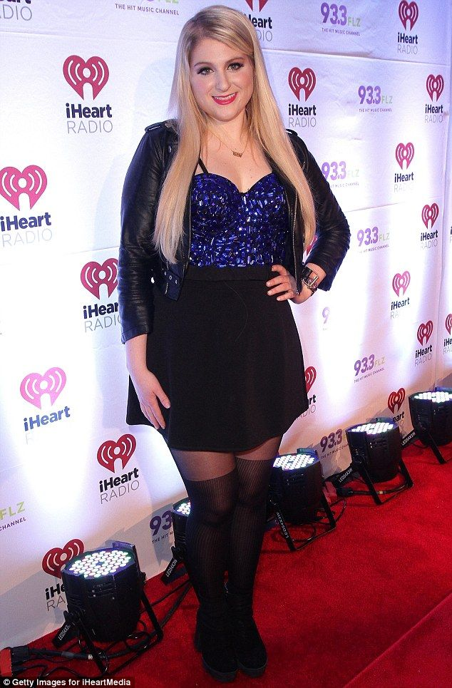 Black and blue: Meghan Trainor aded a blue beaded top to he black jacket and skirt...