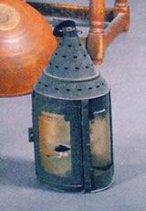 """Image of a horn lantern (Hosted by ImageShack.us) which resembles the mouth parts of sea urchins and sand dollars.  The horn lantern was used in the time of Aristotle and he made the comparison of the lantern to the creature's mouths and gave the mouth parts the name of """"aristotle's lantern"""" by later scientists."""