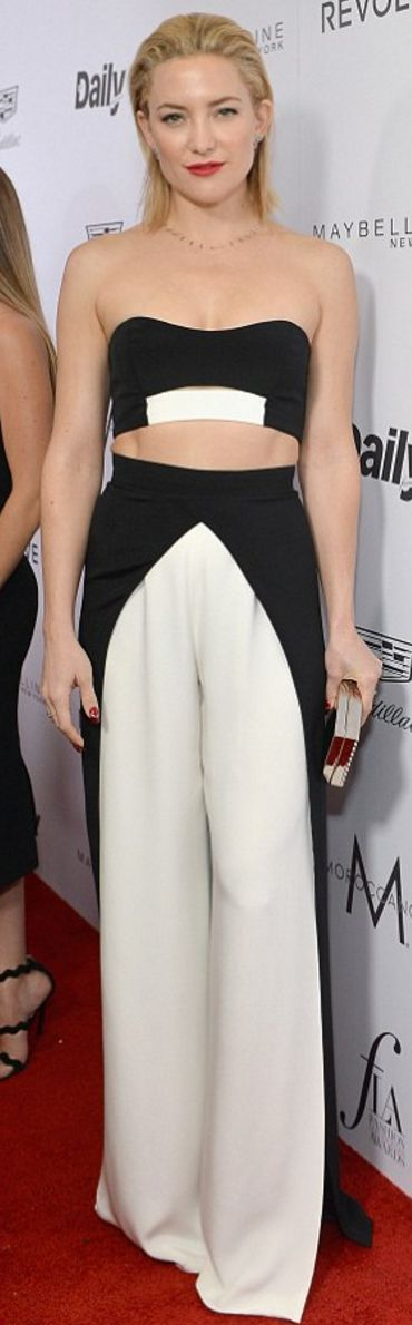 Who made  Kate Hudson's jewelry, crop black top, white pants, and silver clutch handbag?