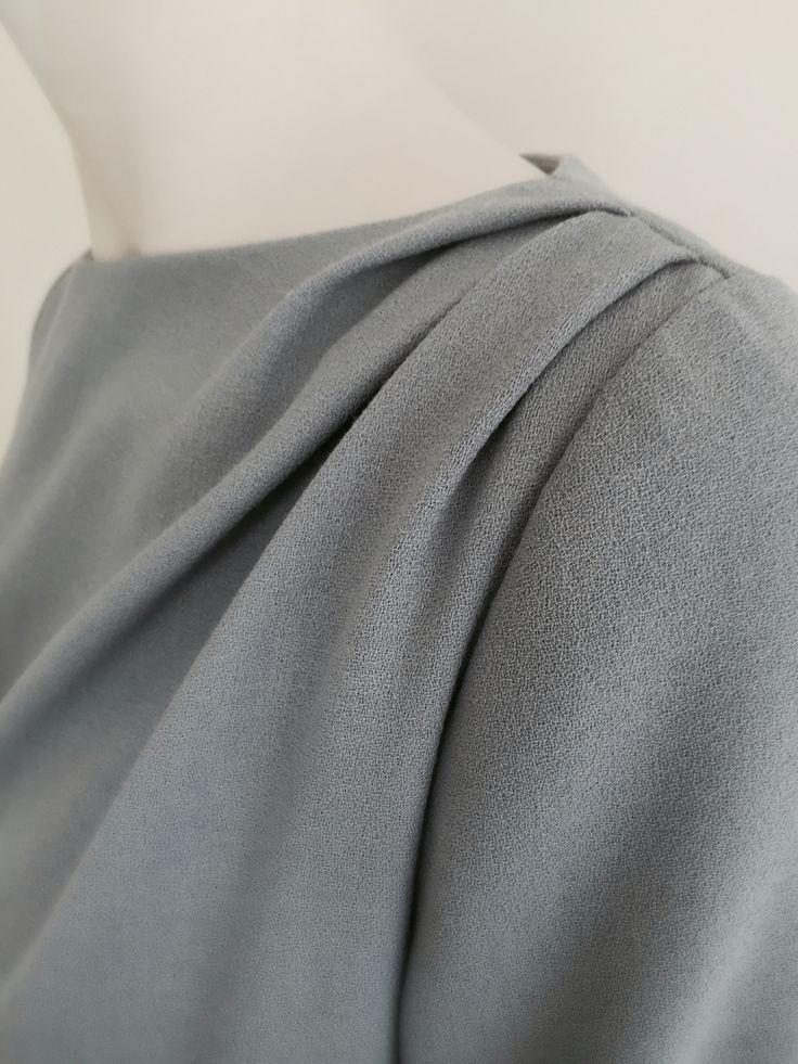 Detail of wool crepe dress