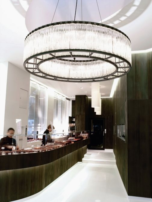 A chocolate shop with a big attractive chandelier  that creates a focal point in the space while adding an elegant and luxurious look.