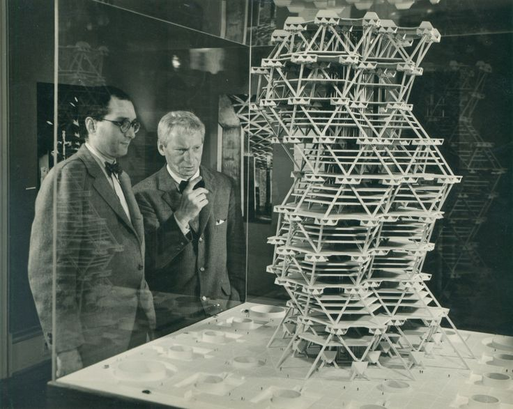 Kahn discusses a model of his unbuilt City Tower Project, on display in a Cornell University exhibition in 1958