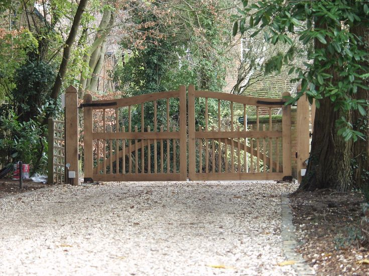wooden driveway gate with double wooden gate