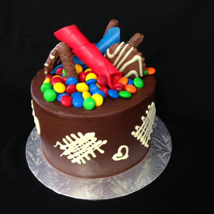 Chocolate Fondant Covered Cake with Chocolate Lolly Overload. Decorated by Coast Cakes Ltd