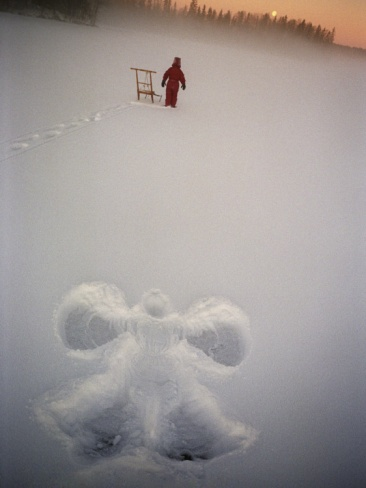 A Figure of an Angel in the Snow and a Child with a Kick Sledge in Background Photographic Print at Art.com: Snow Angel