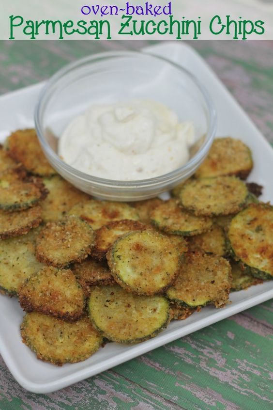 Oven baked Parmesan zucchini chips recipe from This Mama Loves.  They're so crunchy, so delicious- and so much less guilt!
