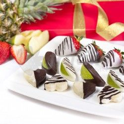 Fruit Heart are hidden in a delicious combination of juicy green apples, pineapples heart and chocolate dipped sweet strawberries. Fruit chocolates are original and healthier option as well as chocolate flower is an unique way to delight and surprise your loved ones.Standart boxes contains 15 pieces of fruit in chocolate, Big boxes contains 20 pieces of fruit in chocolate.