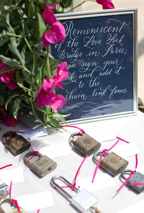 Brides.com: . Inspired by the famous Pont des Arts Bridge in Paris, guests wrote well wishes to the couple on padlocks and attached them to a section of fence in lieu of a traditional guest book.