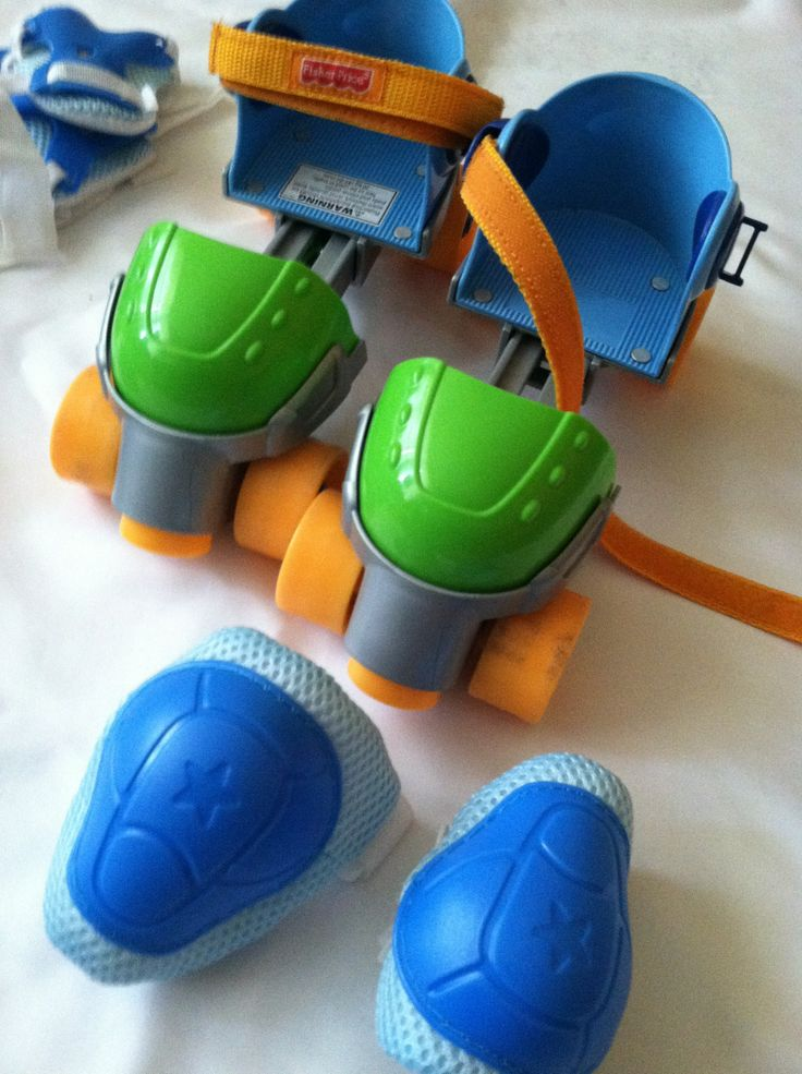 Toddler roller skates.  Fits up to shoe size 12.  Includes knee pads and elbow pads.  Excellent condition.