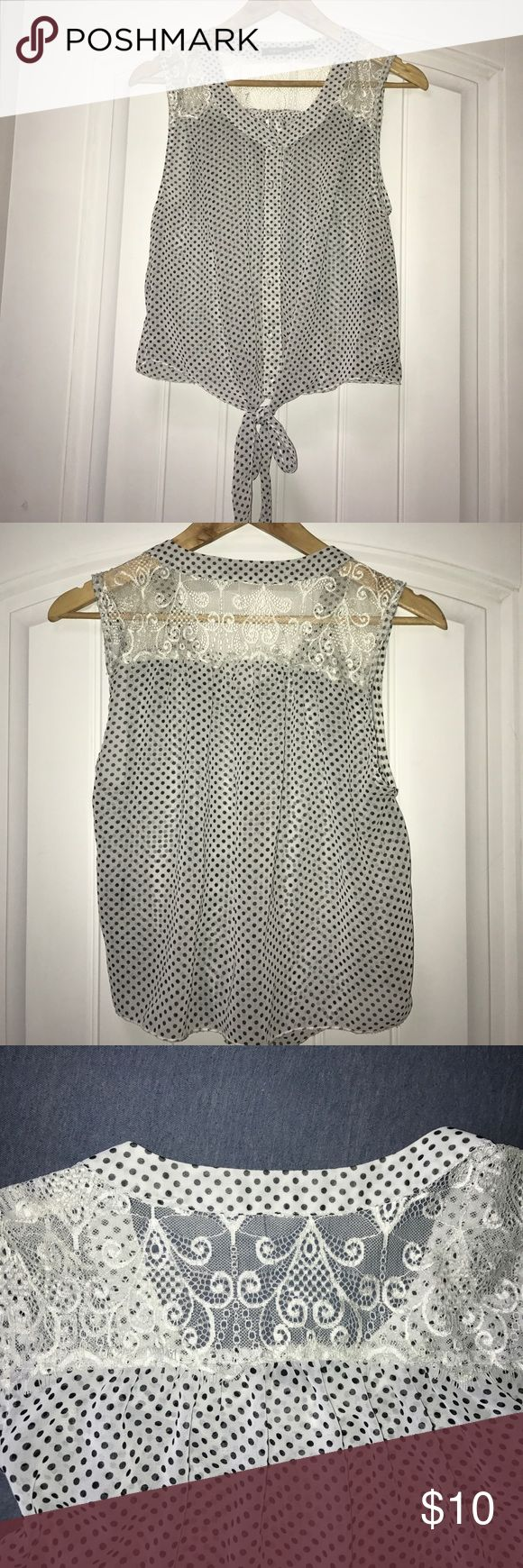 "Poetry Polka Dot Crop Top Sleeveless blouse/crop top with black polka dots and lace detail at the top. Ties at bottom and has matching fabric-covered buttons. Gently used, no rips or stains. 100% polyester Length: 19.5"" Poetry Tops Crop Tops"