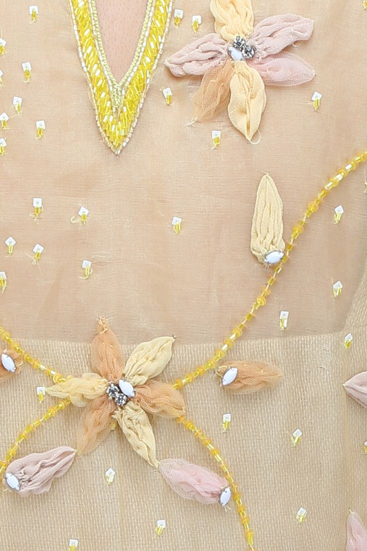 Soft yellow 3D floral applique work straight kurta and beige pants set available only at Pernia's Pop Up Shop.