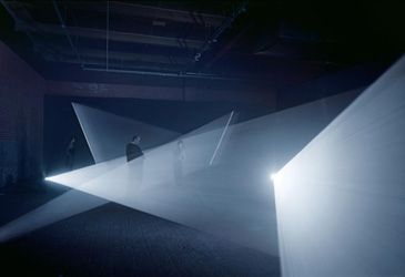 Anthony McCall. Long Film for Four Projectors 1974. Installation view   Solid light installation in five-and-a-half-hour cycles. Four 16 mm film projectors, two haze machines