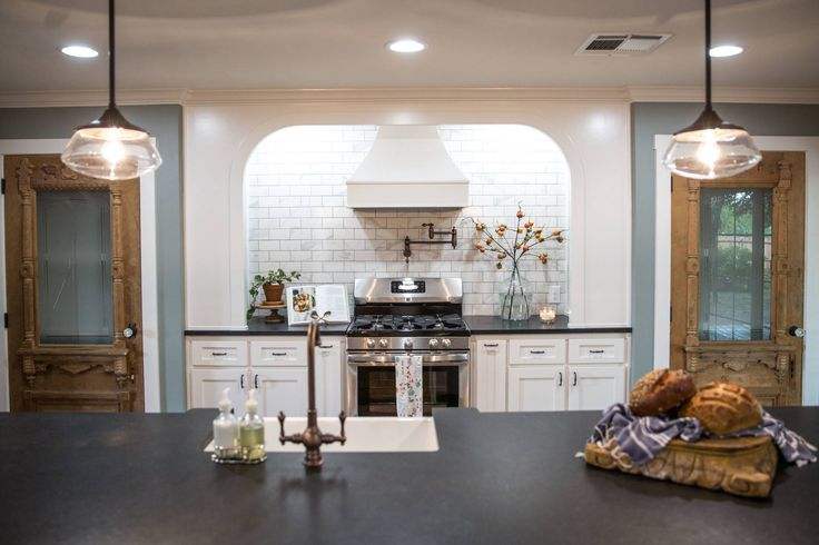 We added this arched built in above the stove that was unlike anything we've ever tried before. I love the way it ties in the arches in the main living space! It created the perfect nooks for dishes and cookbooks and makes the kitchen not only pretty, but also practical.