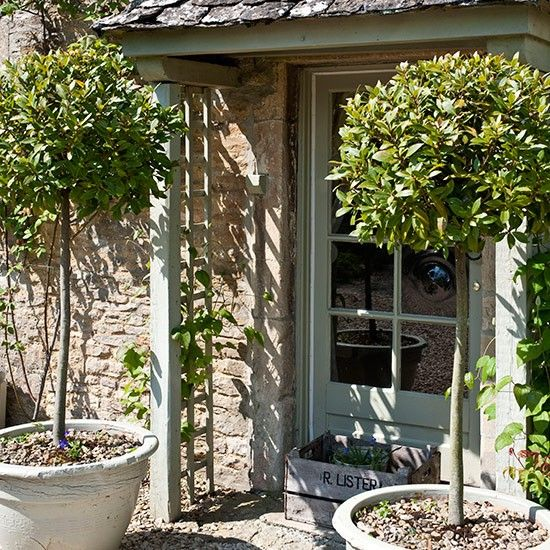 Front porch with trellis and potted bay trees | Front garden design ideas | Garden | PHOTO GALLERY | Country Homes and Interiors | Housetoho...