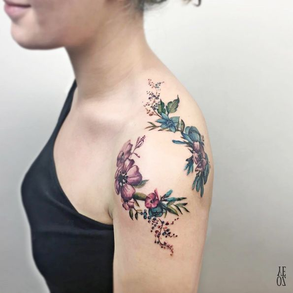 Watercolor flowers on shoulder by Yeliz Ozcan. the colors <3