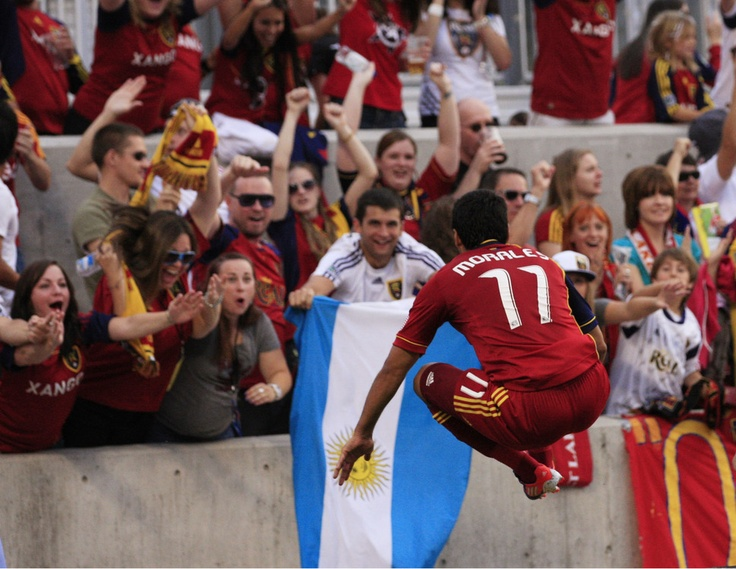 Real Salt Lake midfielder Javier Morales leaps in the air as he hurdles a barricade to celebrate with fans after scoring against the Portland Timbers on Sept. 22, 2012, in Sandy.  (AP Photo/Rick Bowmer)Portland Timber