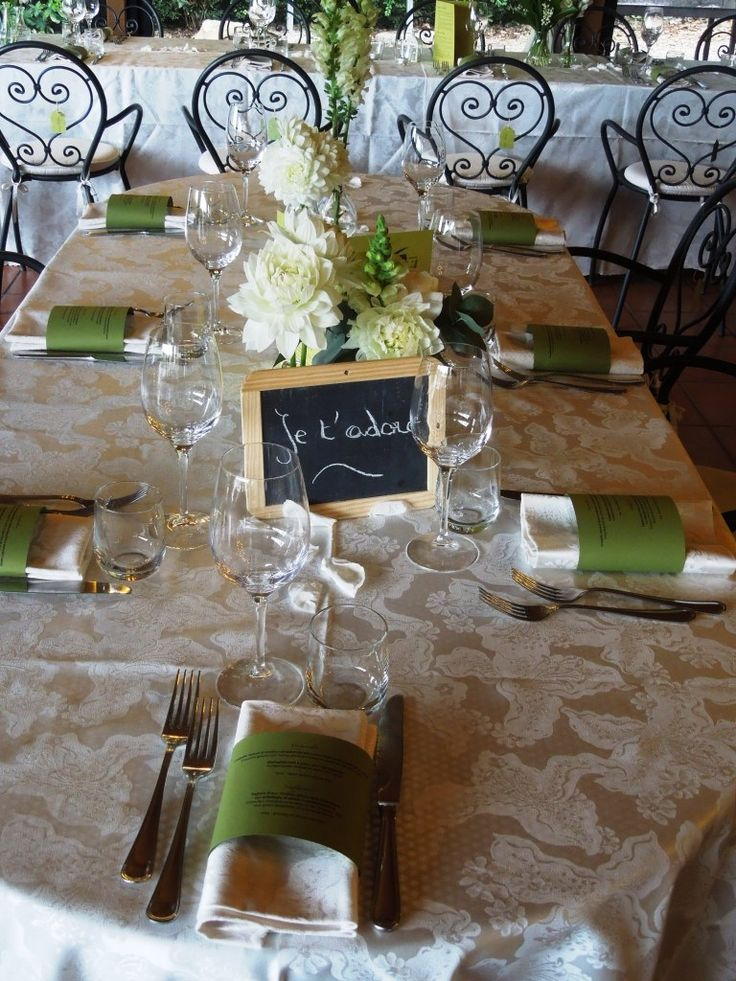 Backstage at the Wedding at Fattoria del Colle: green napkins - ornate table numbers