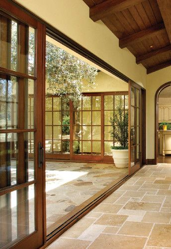 perfect to enclose a narrow verandah connecting different parts of the house - sliding Wood and Glass doors