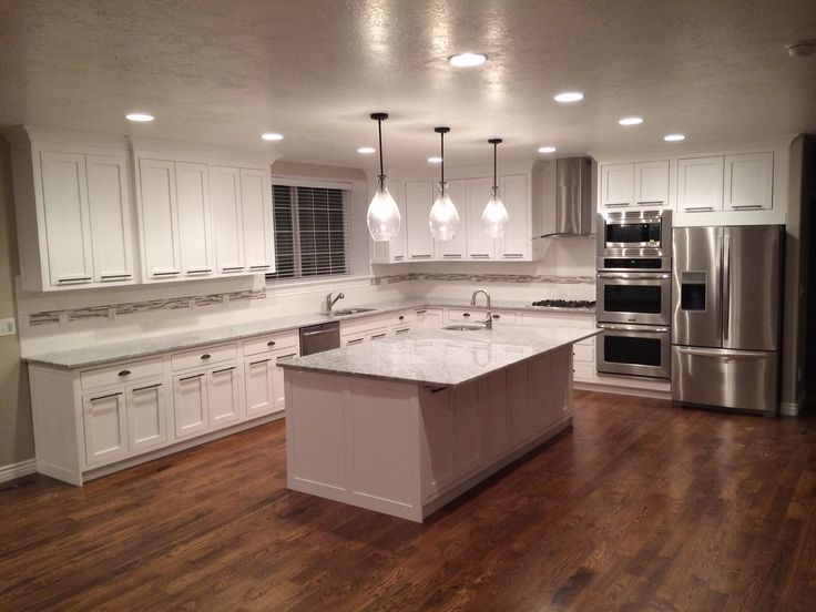 White cabinets hardwood floors look at those floors for Wood floors in kitchen