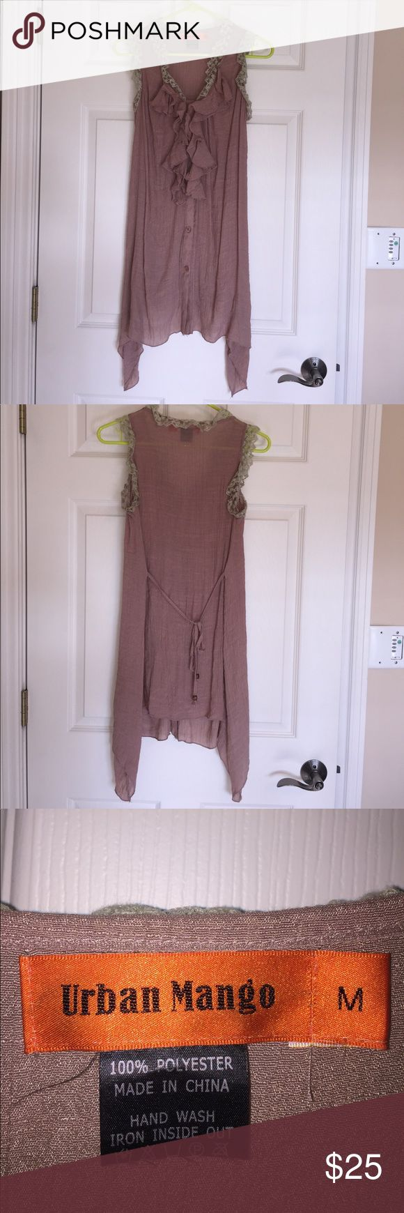 Sleeveless Button Up Top with Lace and Ruffles Sleeveless dusty rose colored tunic top, button up front with a tie back. Ruffles accent the front yoke while a cream colored lace edges the neckline and arm holes. Size medium, rarely worn. Urban Mango Tops Tunics