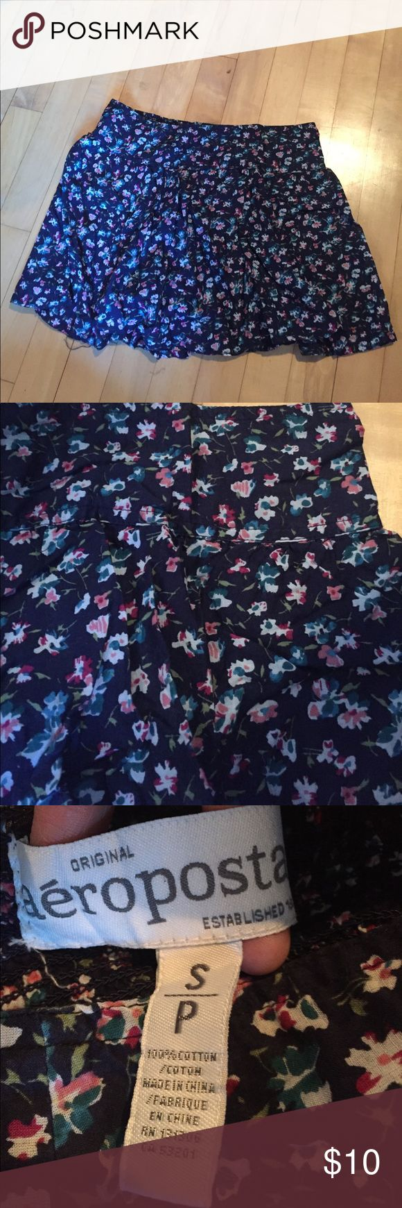 Aeropostale floral skirt cotton small Aeropostale skirt. Women's small. Floral print with navy base. 100% cotton. Pre-loved, but no stains or tears. Any questions please ask! Aeropostale Skirts