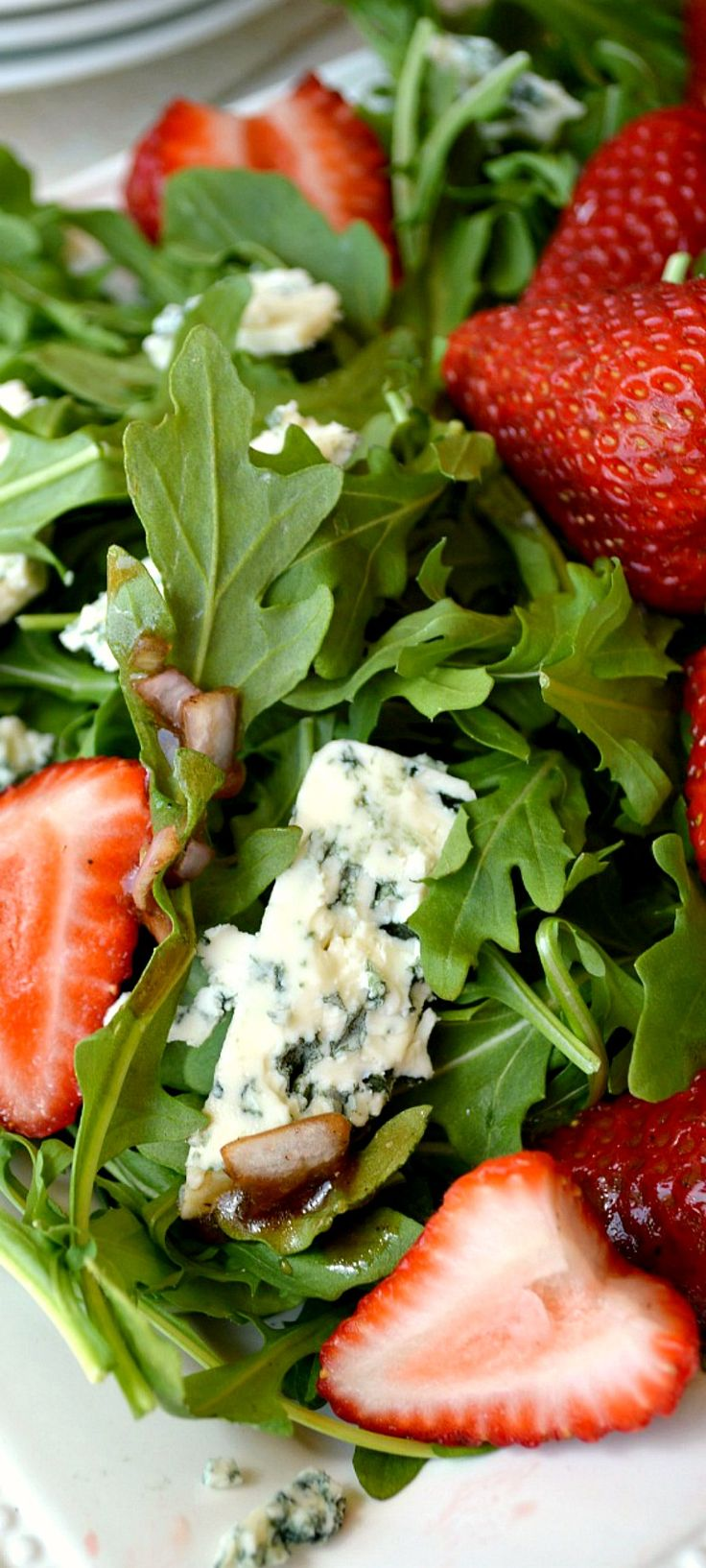 Arugula Strawberry Blue Cheese Salad with Sherry Vinaigrette. This recipe is from the famous SoCal restaurant Lemonades and it's off the charts yummy.  It's simple to make and far more delicious than the sum of it's parts! The Sherry vinaigrette is one of the best salad dressings I've ever had!