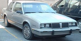 1986 Pontiac 6000 LE Landau.  Bought this from the original owner with 90,000 miles for $200.00.  It had a sunroof, every power option known to mankind, and a completely digital dashboard that lit up at night like the Starship Enterprise.  Drove it for 45,000 miles, and sold it for more than I paid.